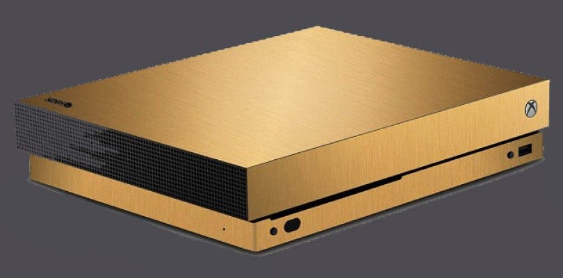El ganador de la Xbox One X de oro la muestra al mundo en un unboxing